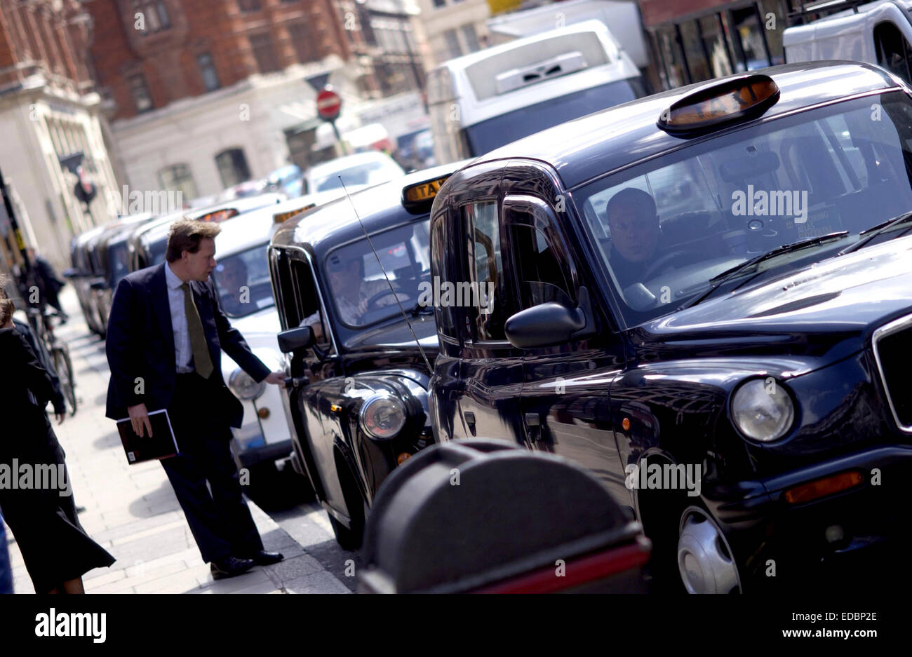 Picture shows a cue of taxis outside Liverpool Street Station, Central London. - Stock Image
