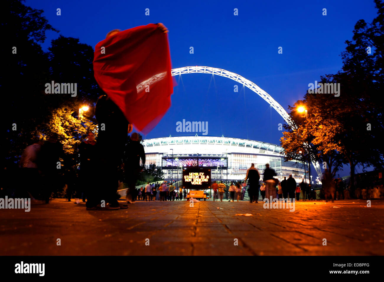 Football supporters before an FA match arrives to the Wembley Arena - Stock Image