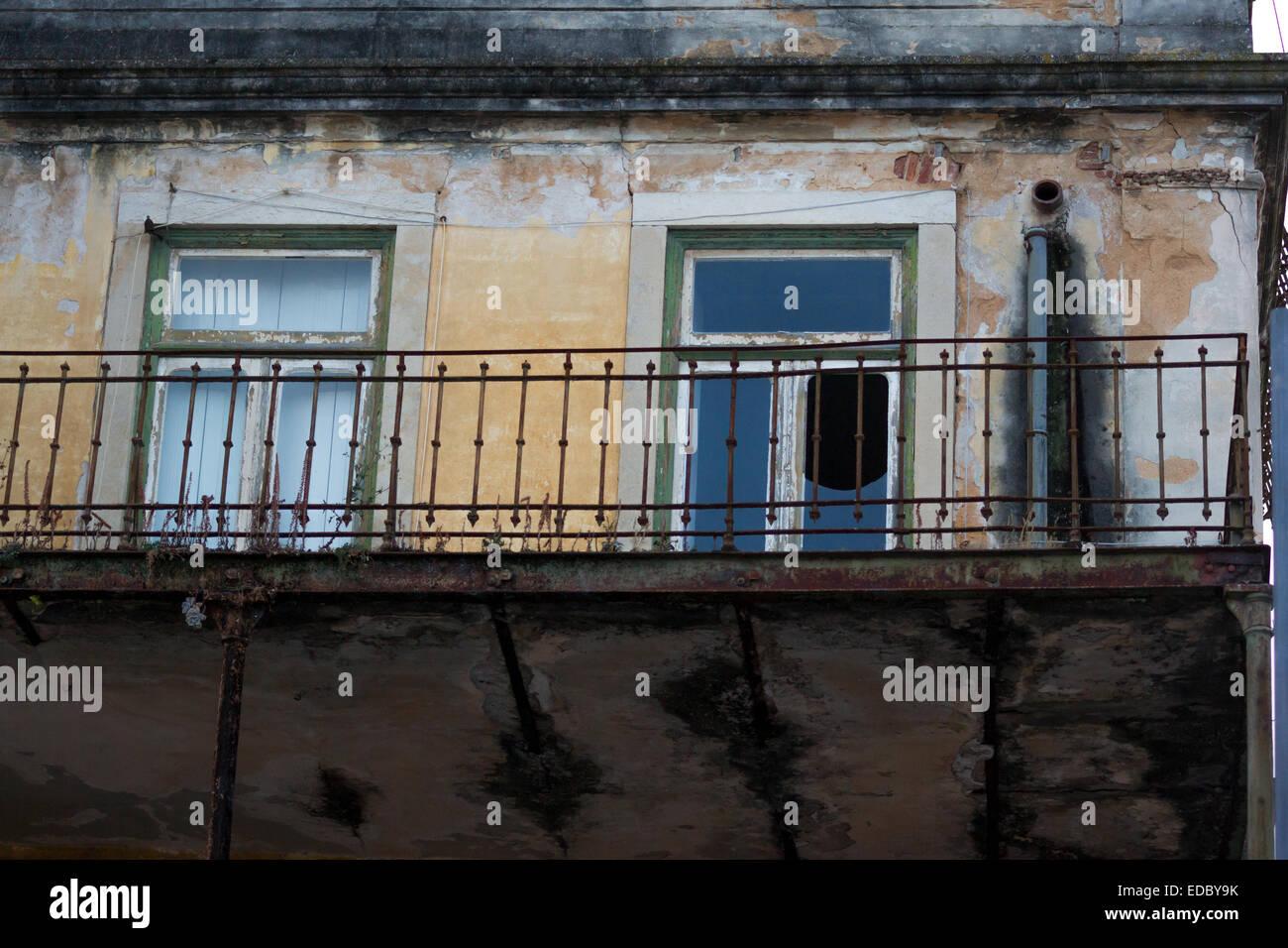 Decrepit balcony in Portugal Stock Photo