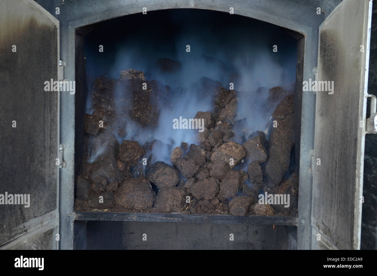 Peat burning at the Laphroaig Whisky Distillery on the island of Islay, Scotland - Stock Image