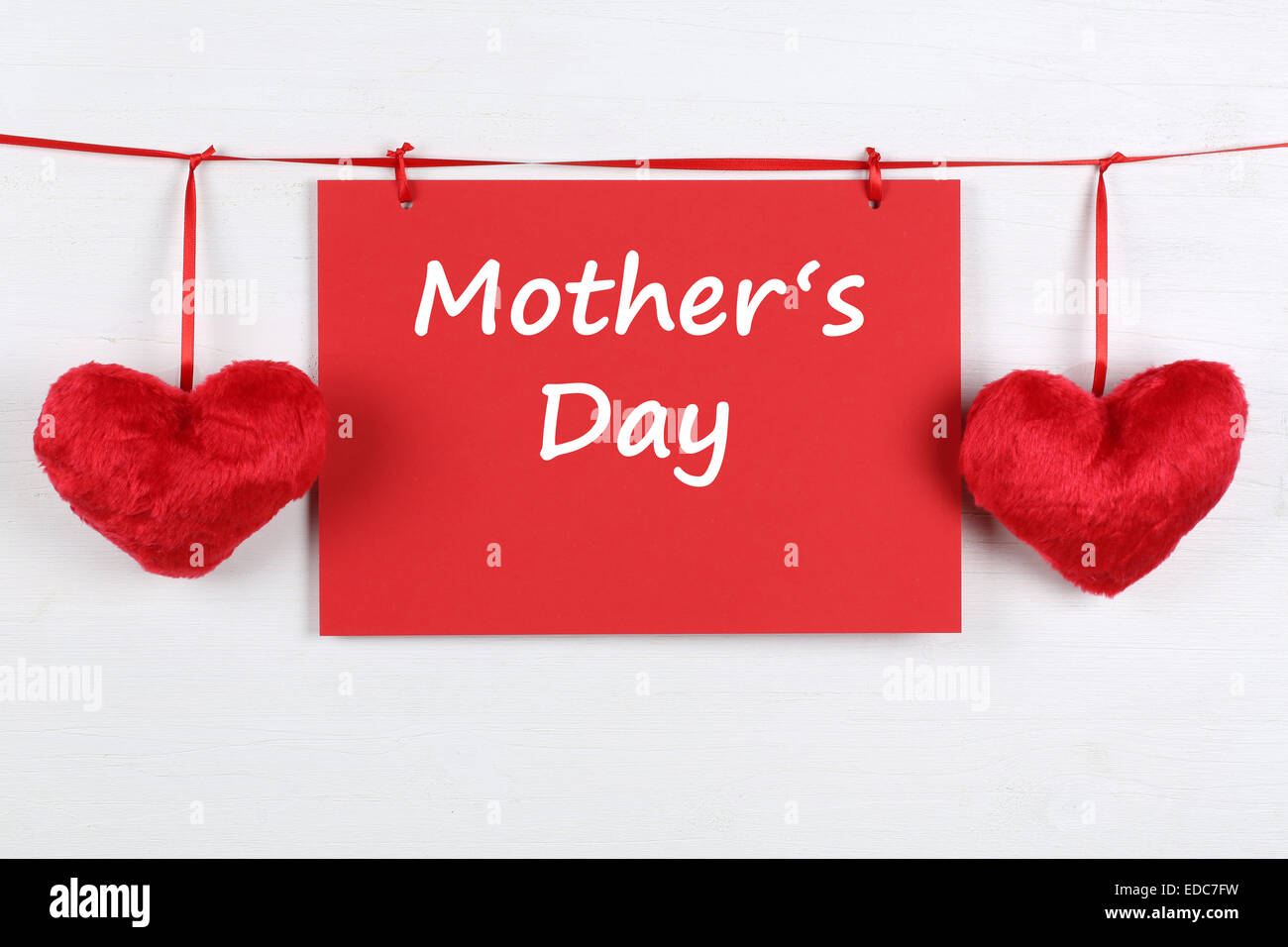 Greeting card on Mother's day with copyspace for your own text and two hearts - Stock Image