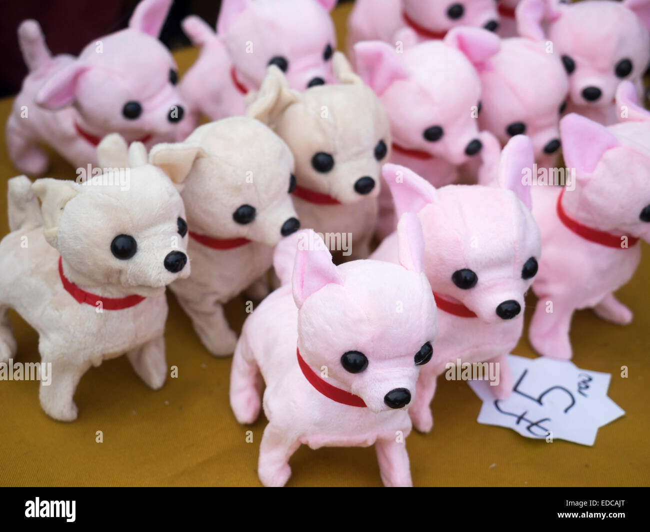 small pink toy dogs on sale Bakewell town before Christmas in Derbyshire England - Stock Image