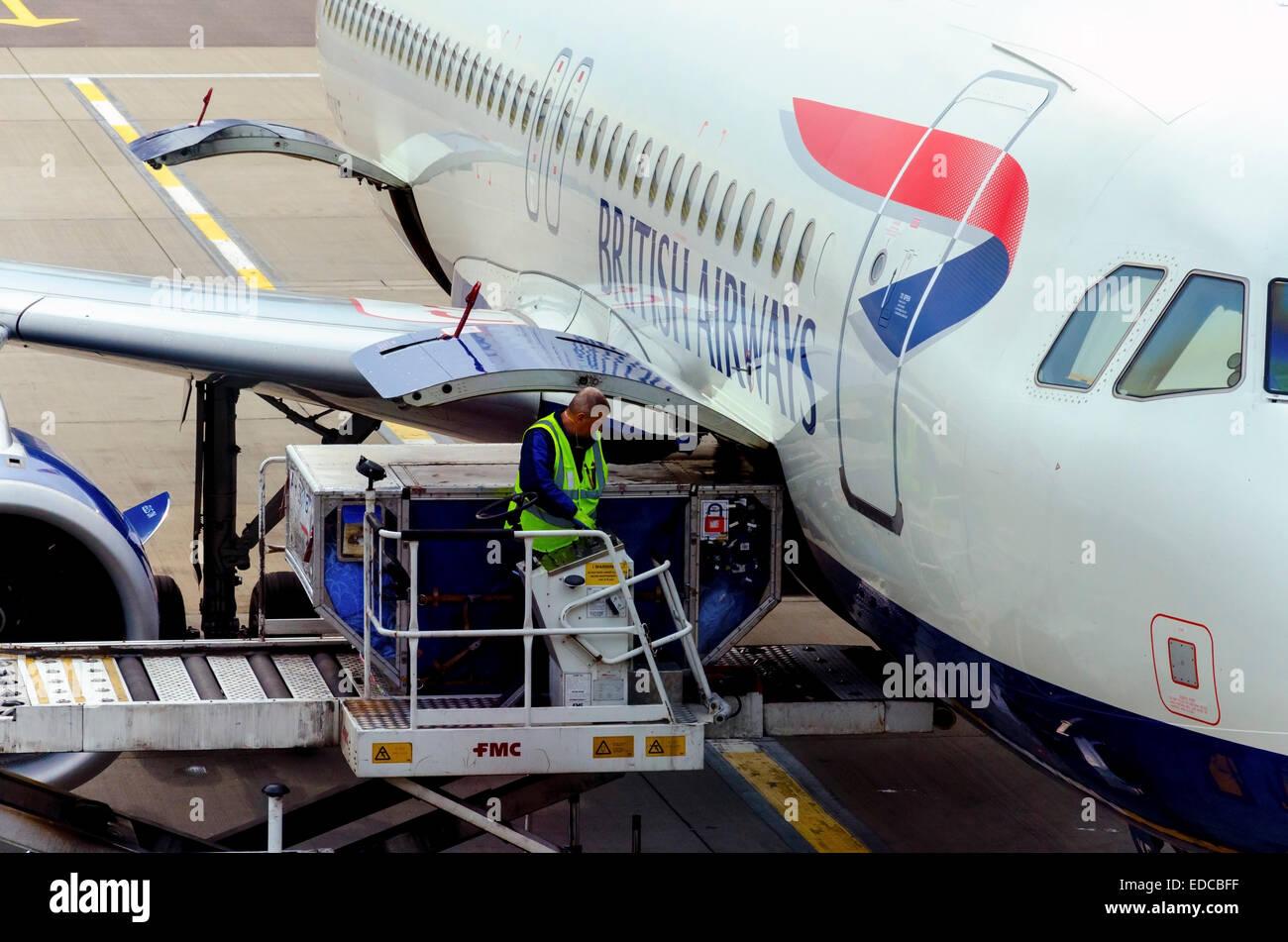 BA plane loading at Heathrow - Stock Image
