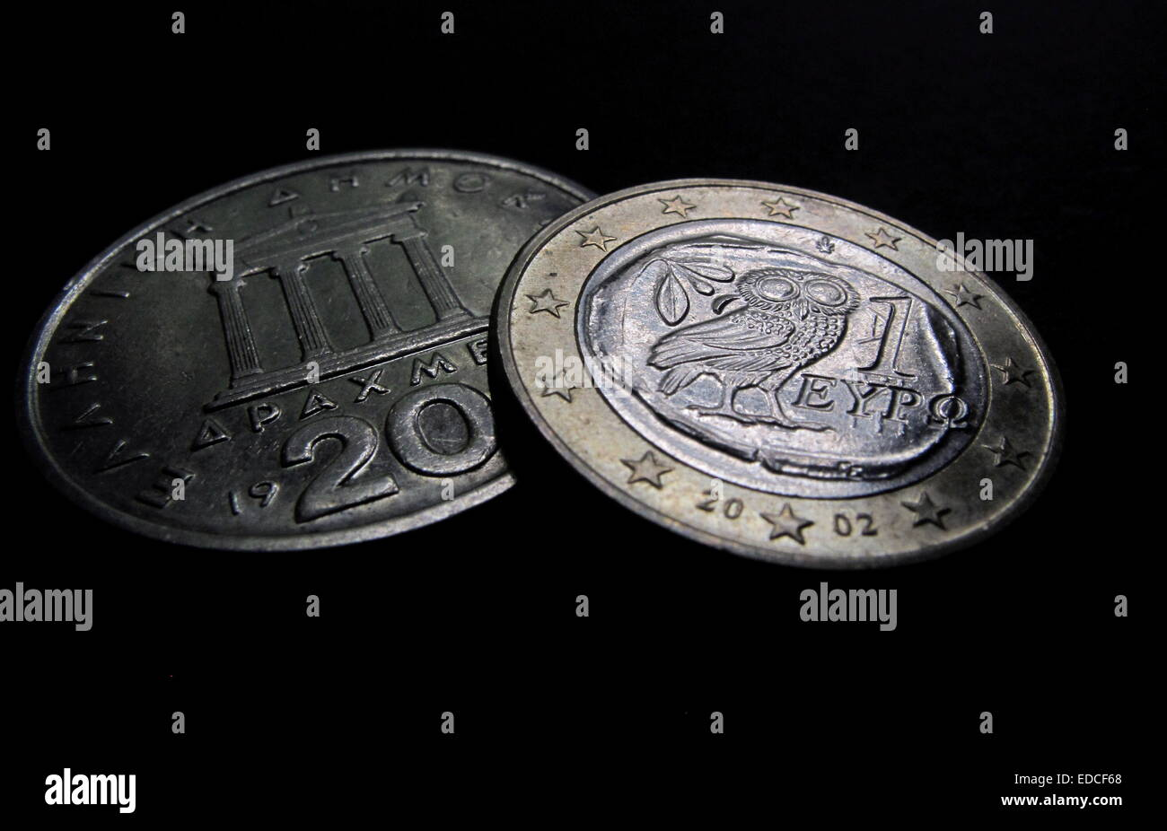 File - Illustration - An archive picture dated 03 May 2010 shows a Greek Euro coin and a Greek 20 Drachm coin. After - Stock Image