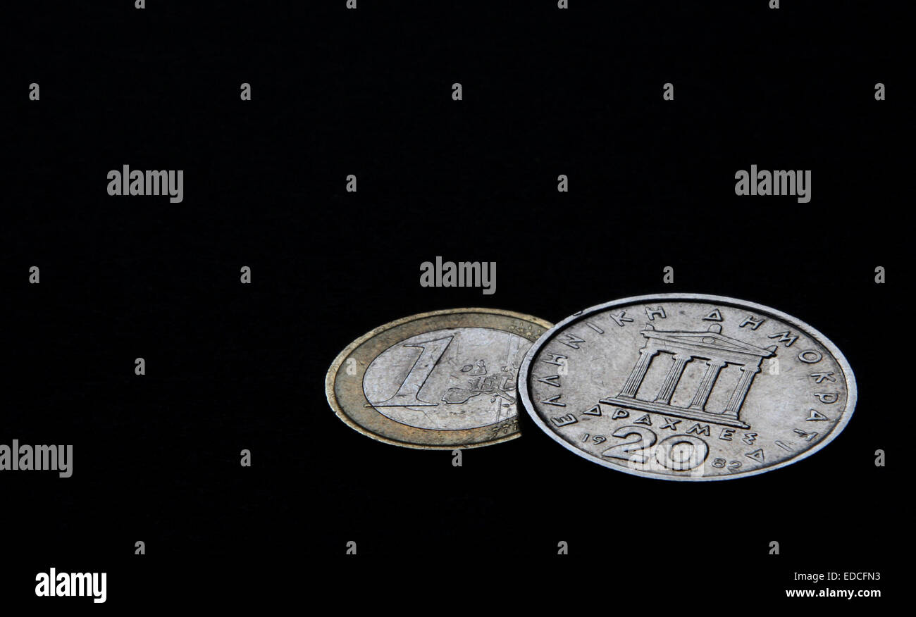 Wuerzburg, Germany. 03rd Nov, 2011. ILLUSTRATION - A Greek 20 drachm coin and a one-euro coin are pictured in Wuerzburg, - Stock Image