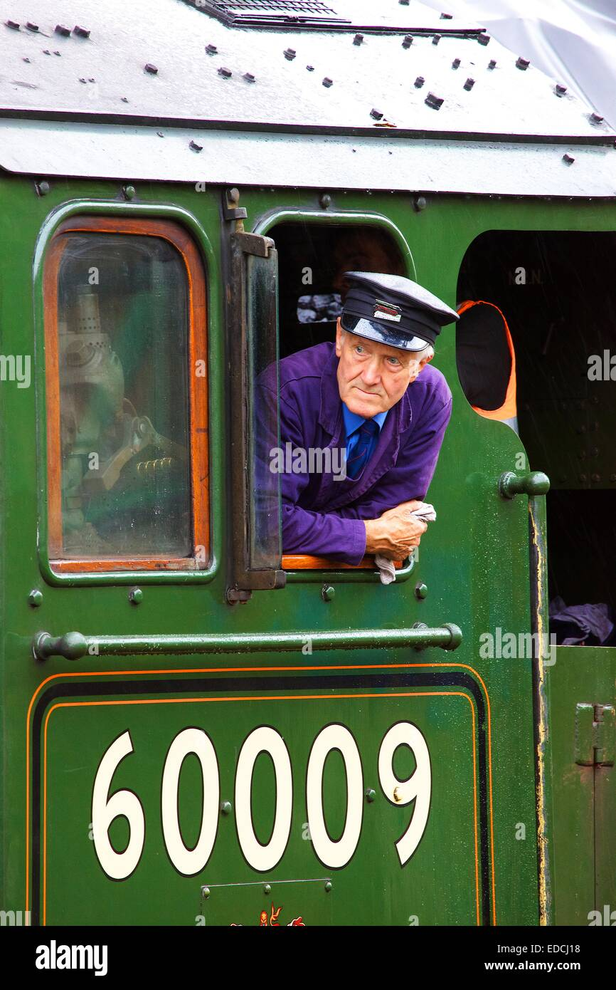 Engine driver looking out of the cab of the LNER Class A4 60009 Union of South Africa. - Stock Image