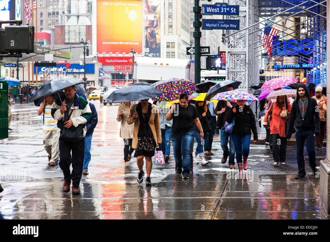 Wet raining winter day Manhattan New York City rain weather NY NYC USA America United States miserable winters downpour - Stock Image