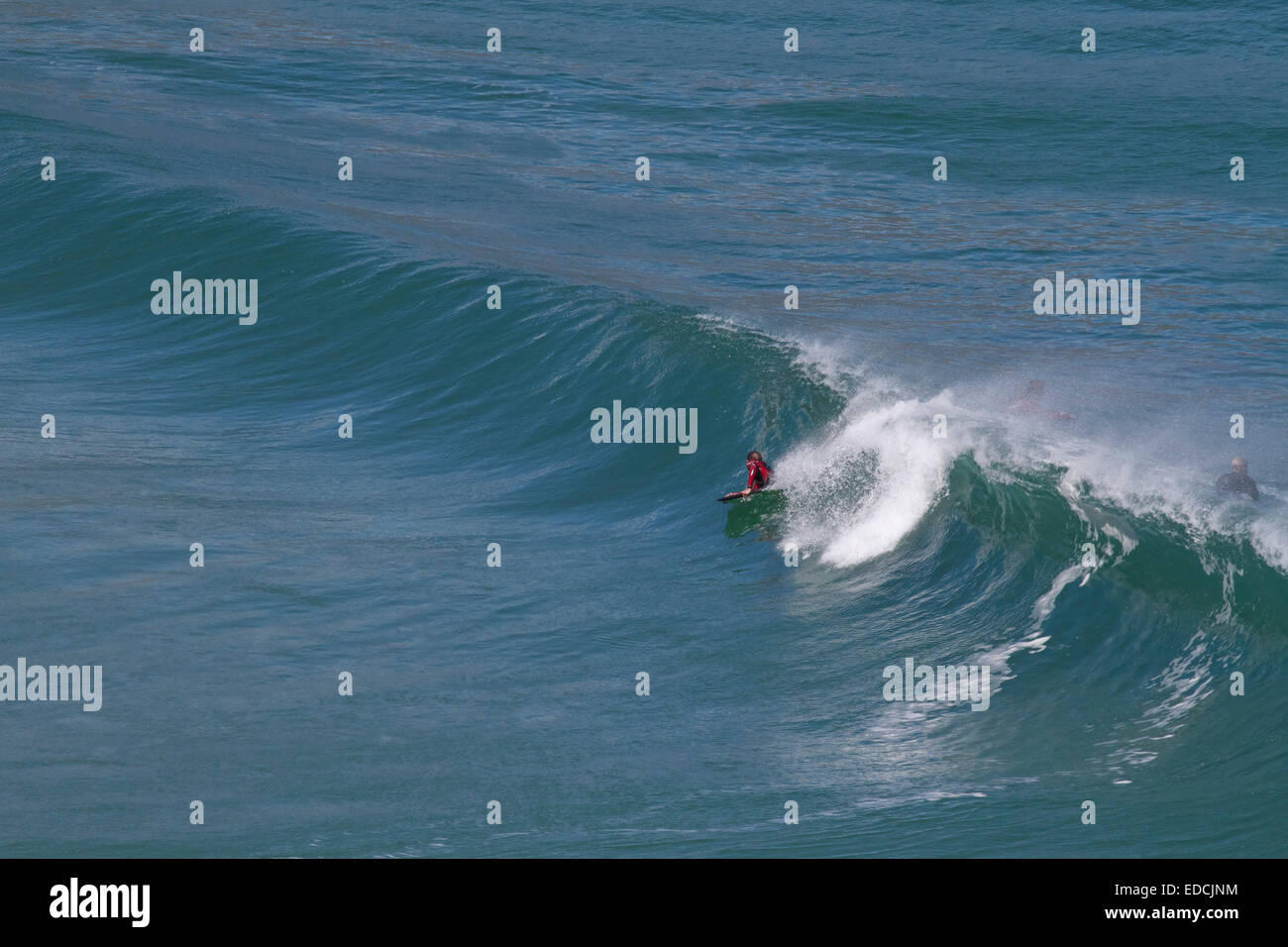Surfer. Ocean. Waves. Bettysbaai, Betty's Bay. Western Cape. South Africa. Tourism. Kleinmond. Sea. Holiday destination. Stock Photo