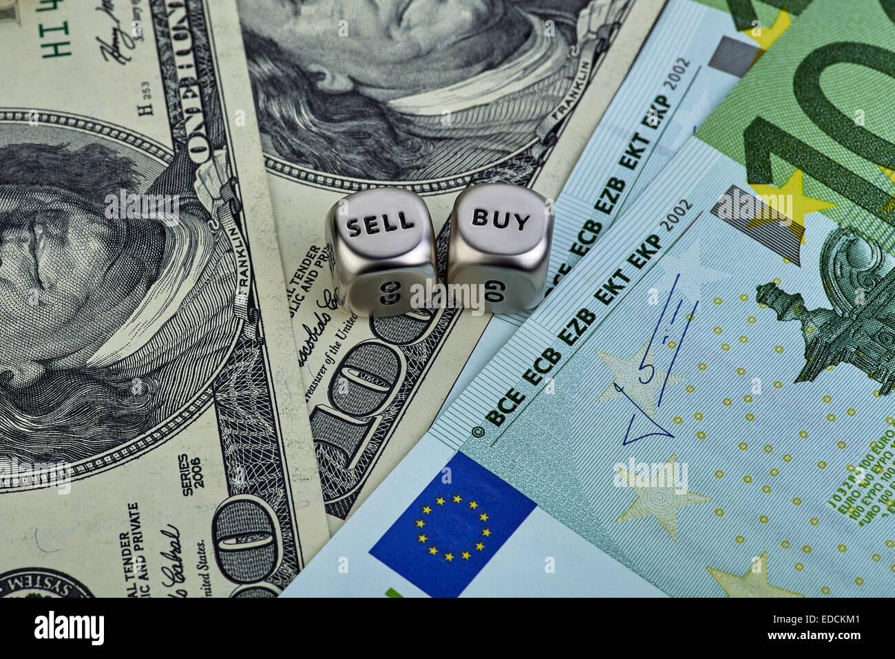 USD EUR banknotes, dices cubes. Selecnive focus - Stock Image