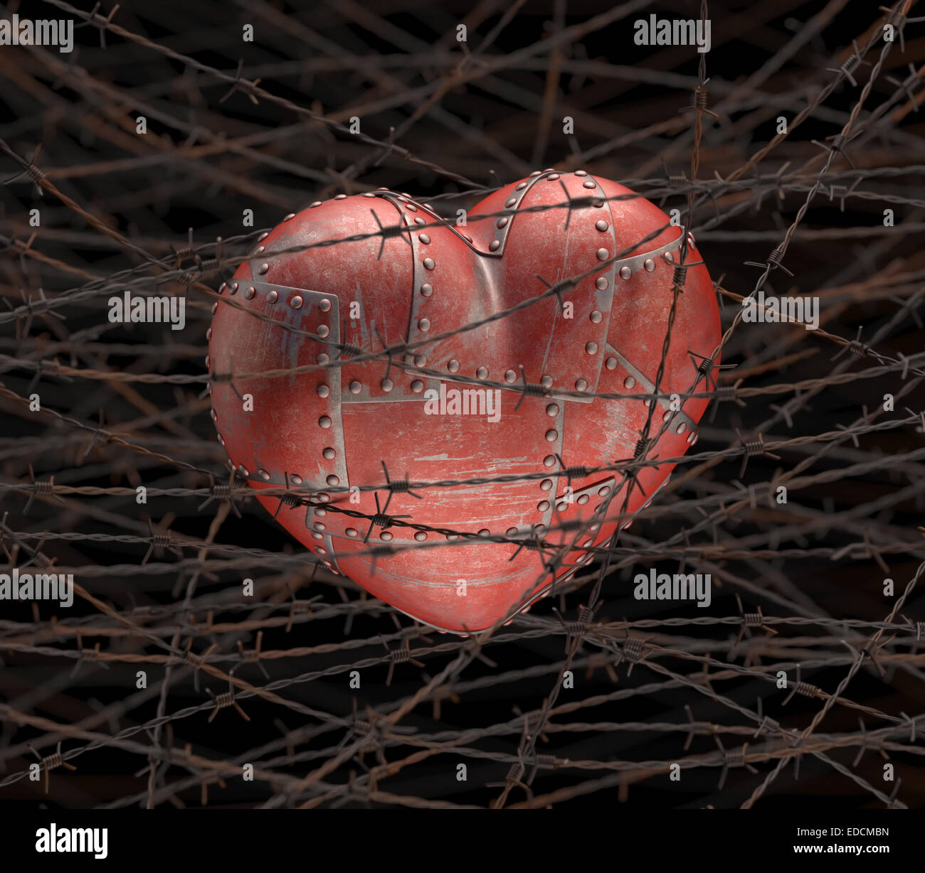 Metal heart with barbed wire around. - Stock Image