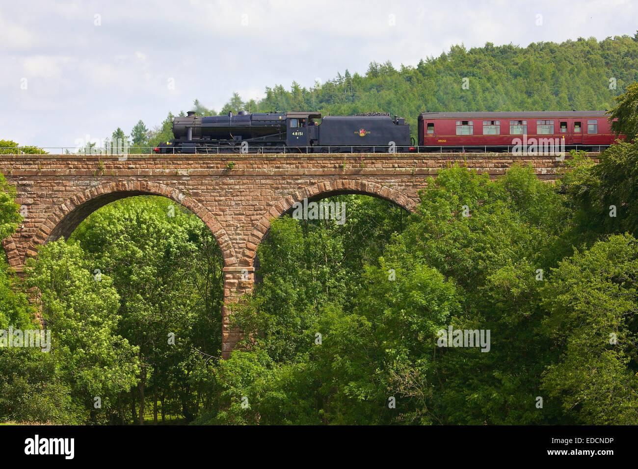 Steam train passing over Armathwaite Viaduct, Armathwaite Settle to Carlisle Railway Line, Eden Valley, Cumbria, - Stock Image