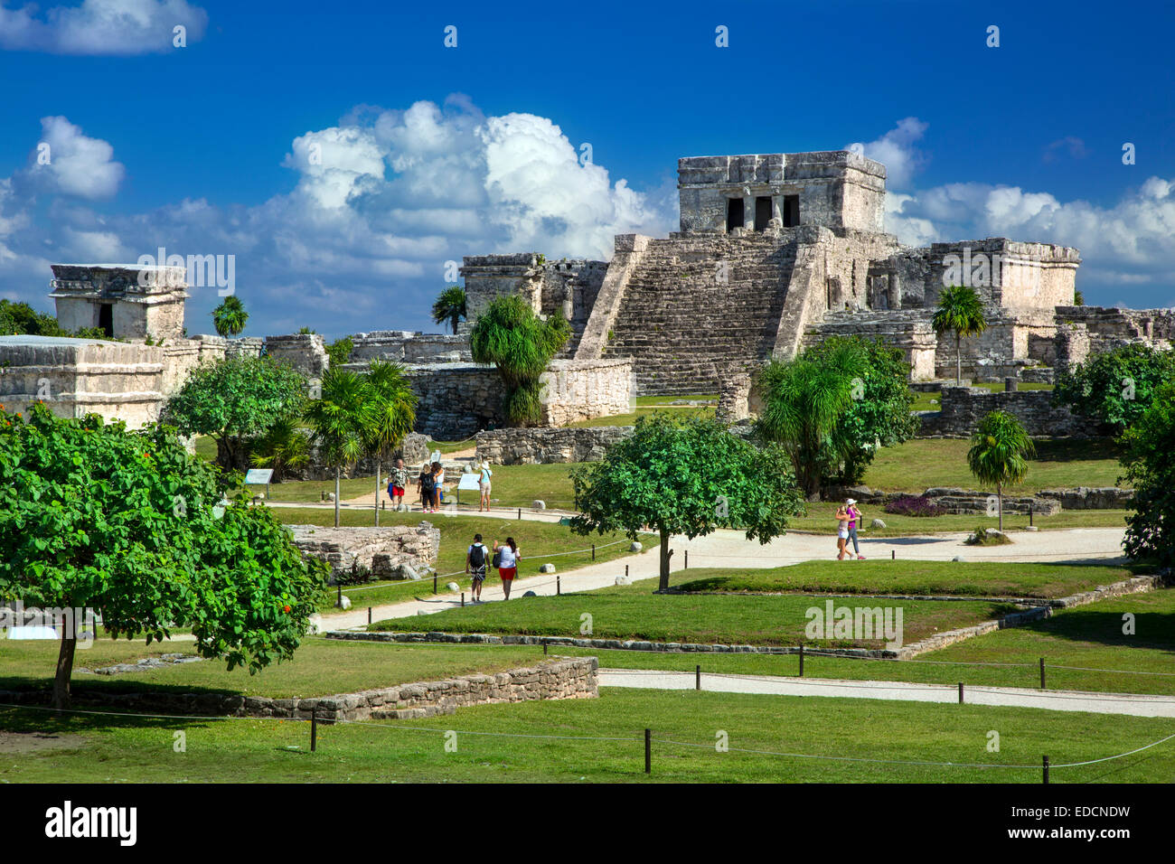 Tourists visiting the ruins of the Mayan temple grounds at Tulum, Quintana Roo, Yucatan, Mexico - Stock Image