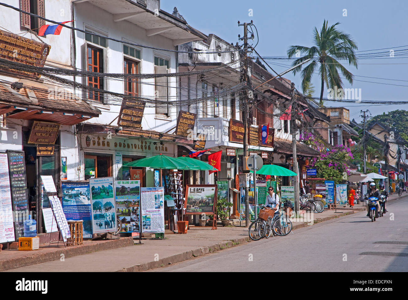 Touring offices offering guided tours for tourists in the main street at Luang Prabang, Louangphrabang Province, - Stock Image