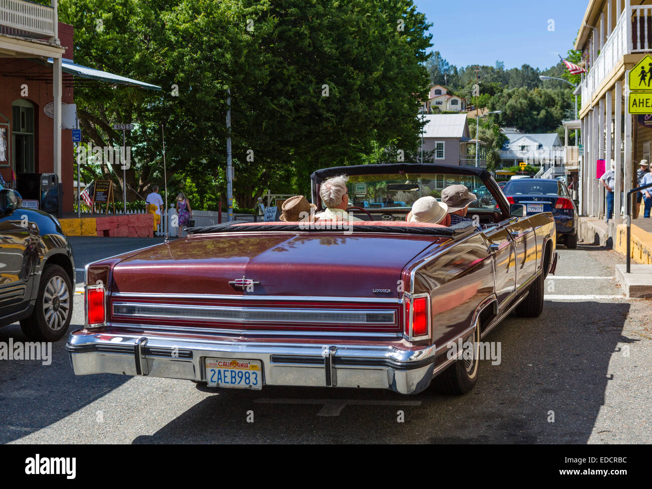 Elderly couples driving down Main Street in an old Lincoln convertible, Sutter Creek, Southern Gold Country, California, - Stock Image
