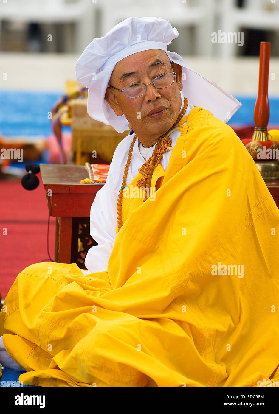 A monk from the Nipponzan Myohoji Order, a branch of Japanese Nichiren Buddhism, taking part in the annual commemoration - Stock Image