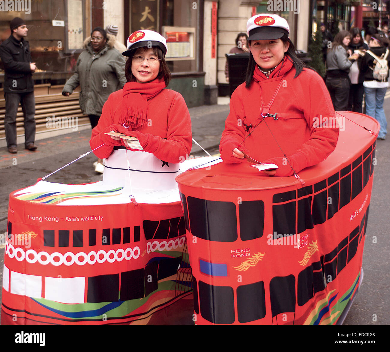Two ladies promote Hong Kong in London's Chinatown during the Chinese New Year celebrations. - Stock Image