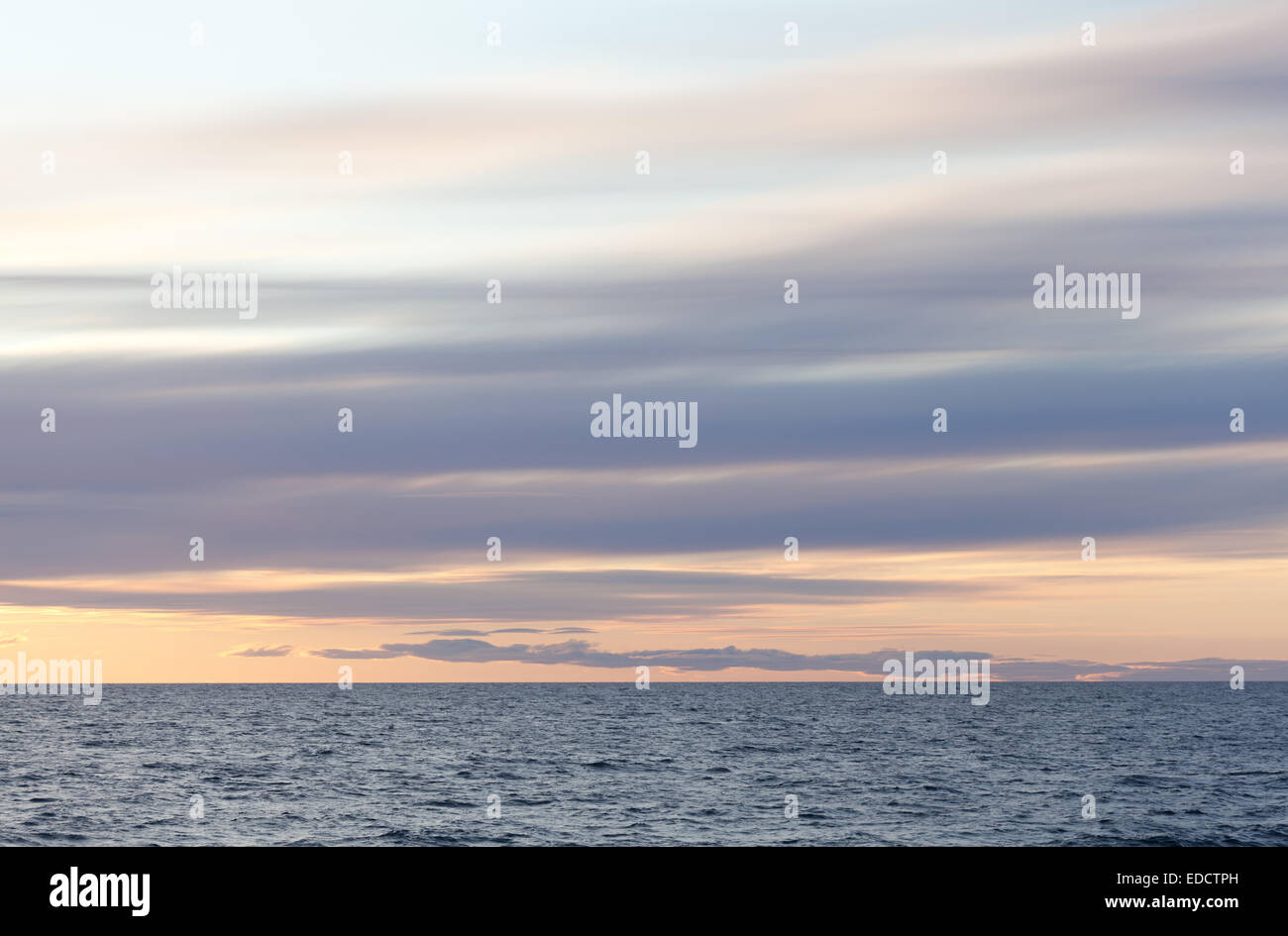 Stratus clouds over the sea Stock Photo
