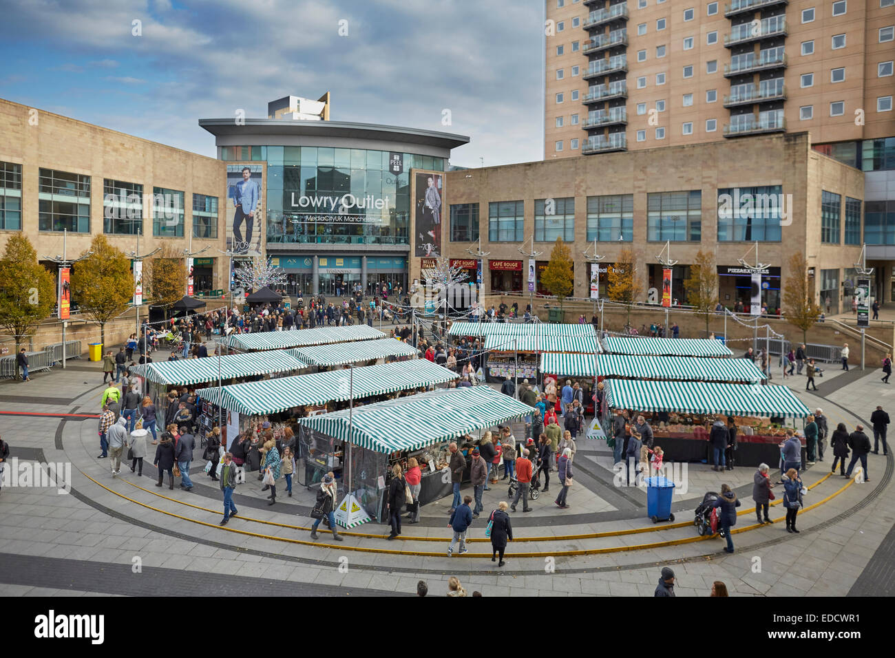 Salford Quays Lowry Outlet Mall  with a market outside - Stock Image