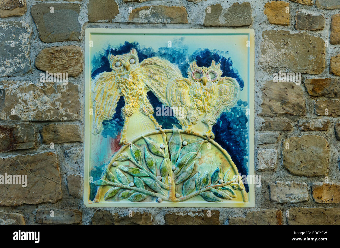 two owl  in an old  wall tile - Stock Image