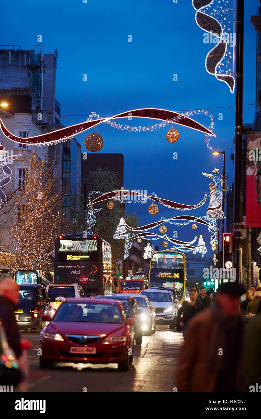 Manchester Christmas Markets and lights 2014, decorative festive lights over Deansgate - Stock Image