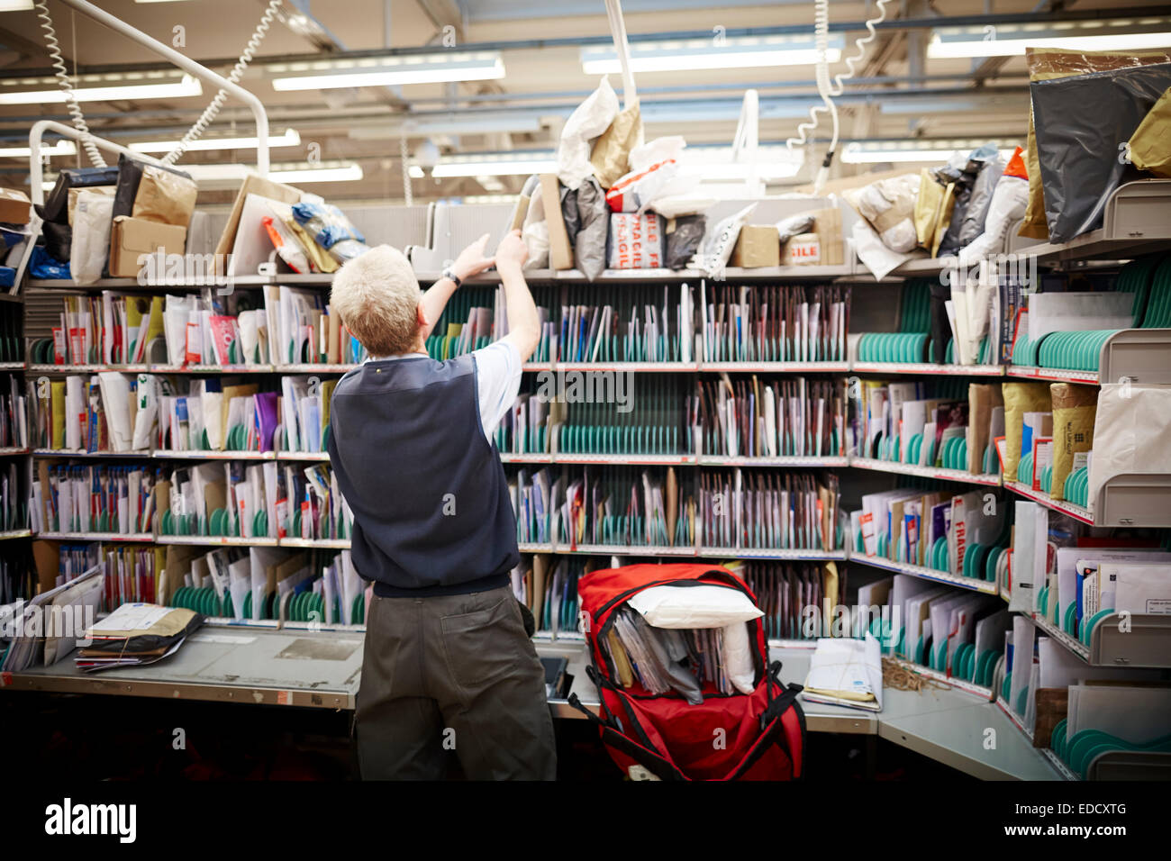 Royal Mail Manchester South delivery office workers sorting the mail by hand - Stock Image