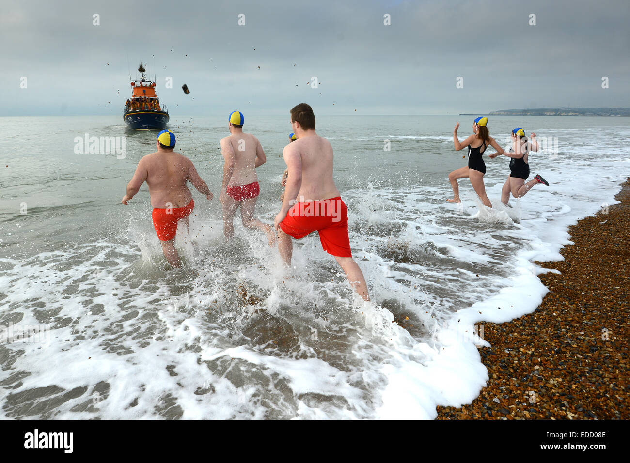 New Year dip in the sea by Seaford Lifeguards, Seaford Bay, Sussex, UK - Stock Image