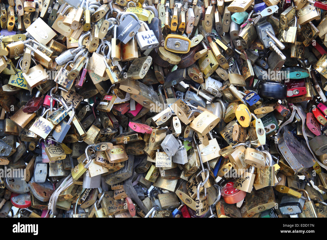 The 'Love lock' bridge in Paris, with it's railings covered in padlocks, the Pont Des Arts, in France, - Stock Image