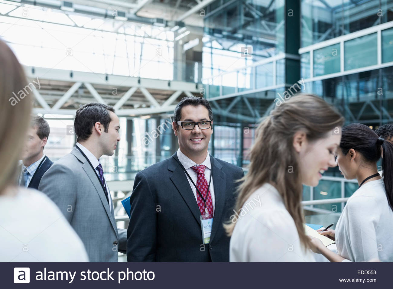 Portrait of confident businessman at conference - Stock Image
