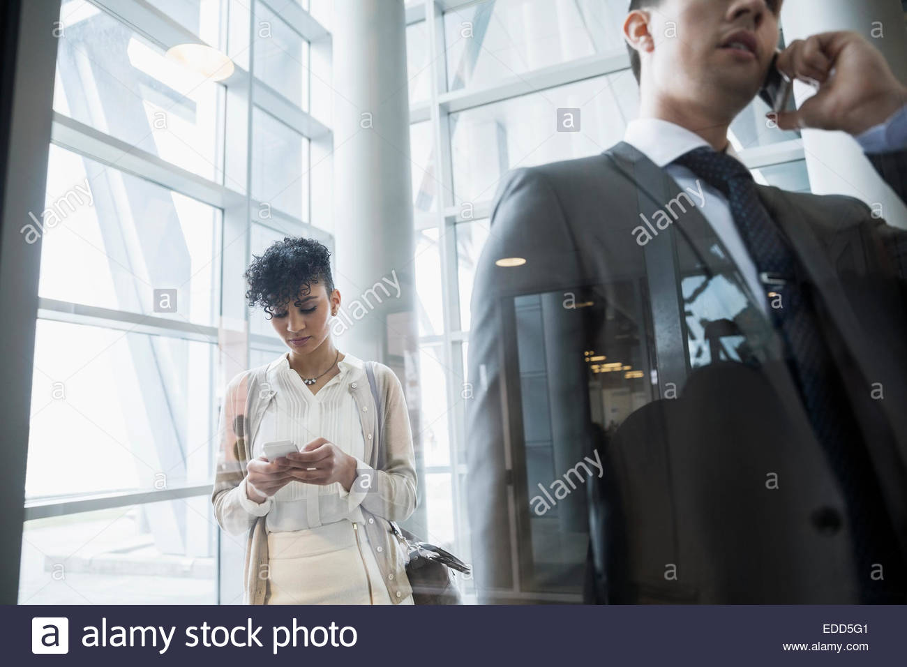 Business people with cell phones - Stock Image