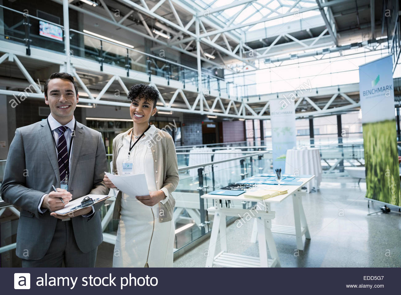 Portrait of confident business people at conference registration - Stock Image