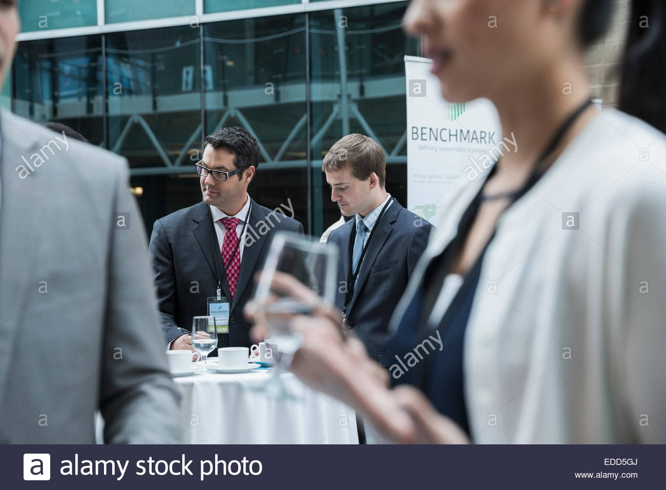 Business people networking at conference - Stock Image