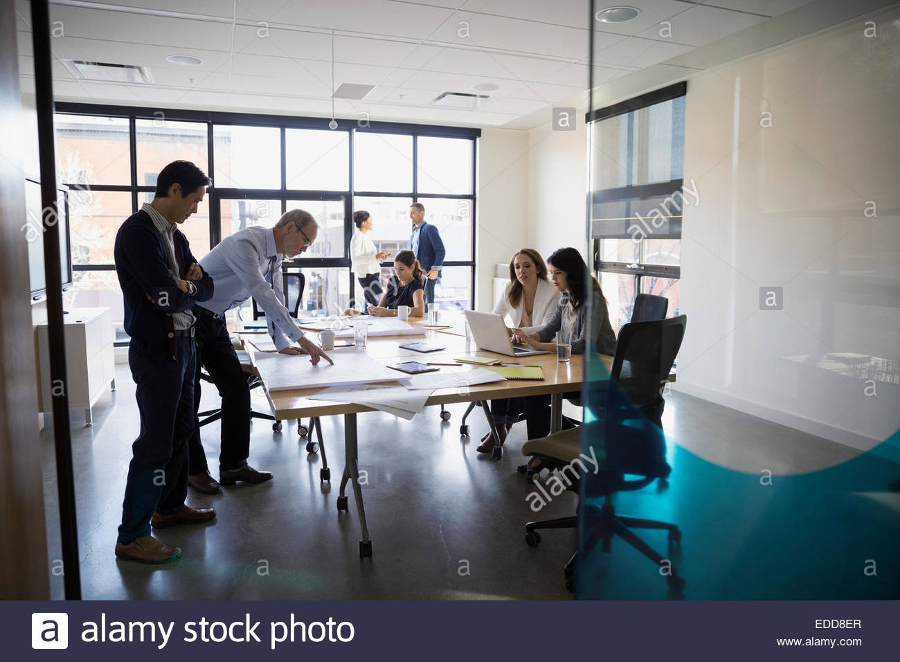 Business people working in conference room - Stock Image