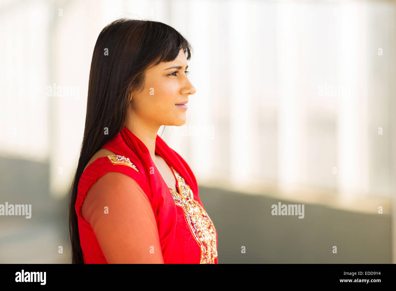 thoughtful Indian businesswoman wearing saree in office Stock Photo
