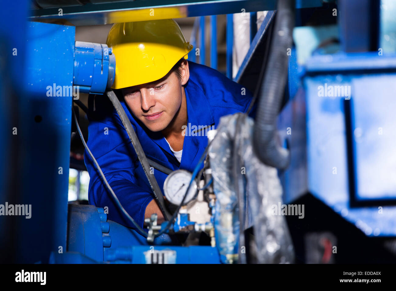 young industrial machine operator at work - Stock Image