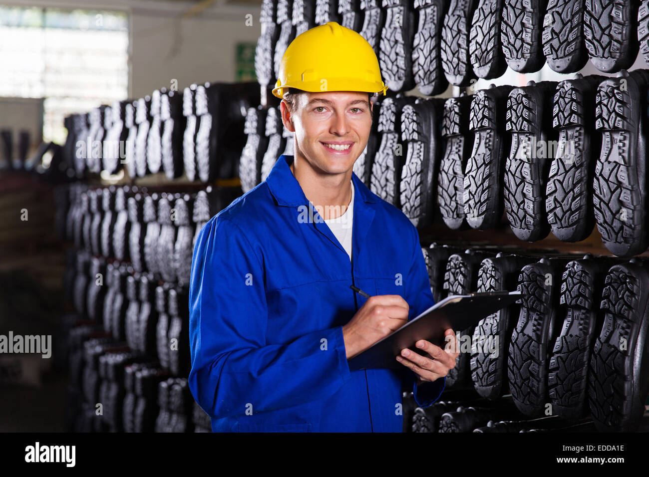 portrait of handsome gumboots factory quality controller - Stock Image