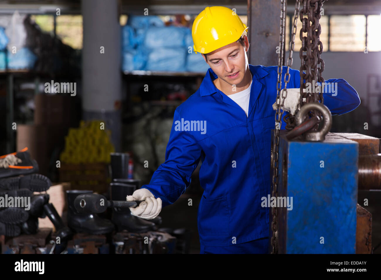 young industrial craftsman working in workshop - Stock Image