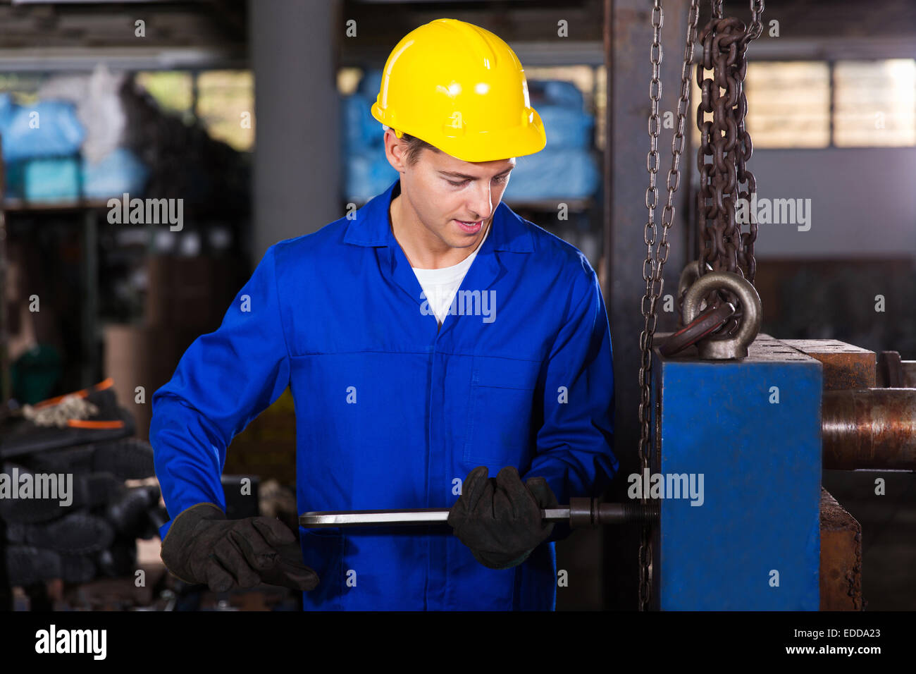 skilled manual worker working in workshop - Stock Image