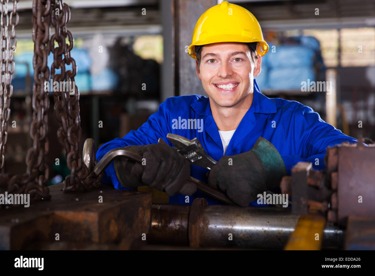 portrait of industrial manual worker in workshop - Stock Image