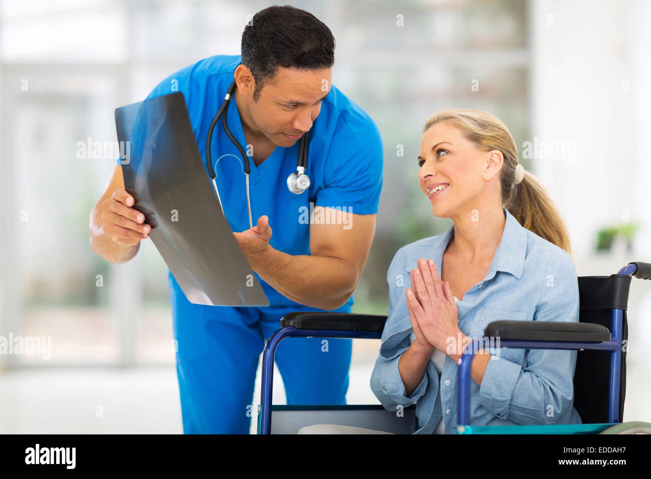 senior disabled woman begging doctor for help - Stock Image