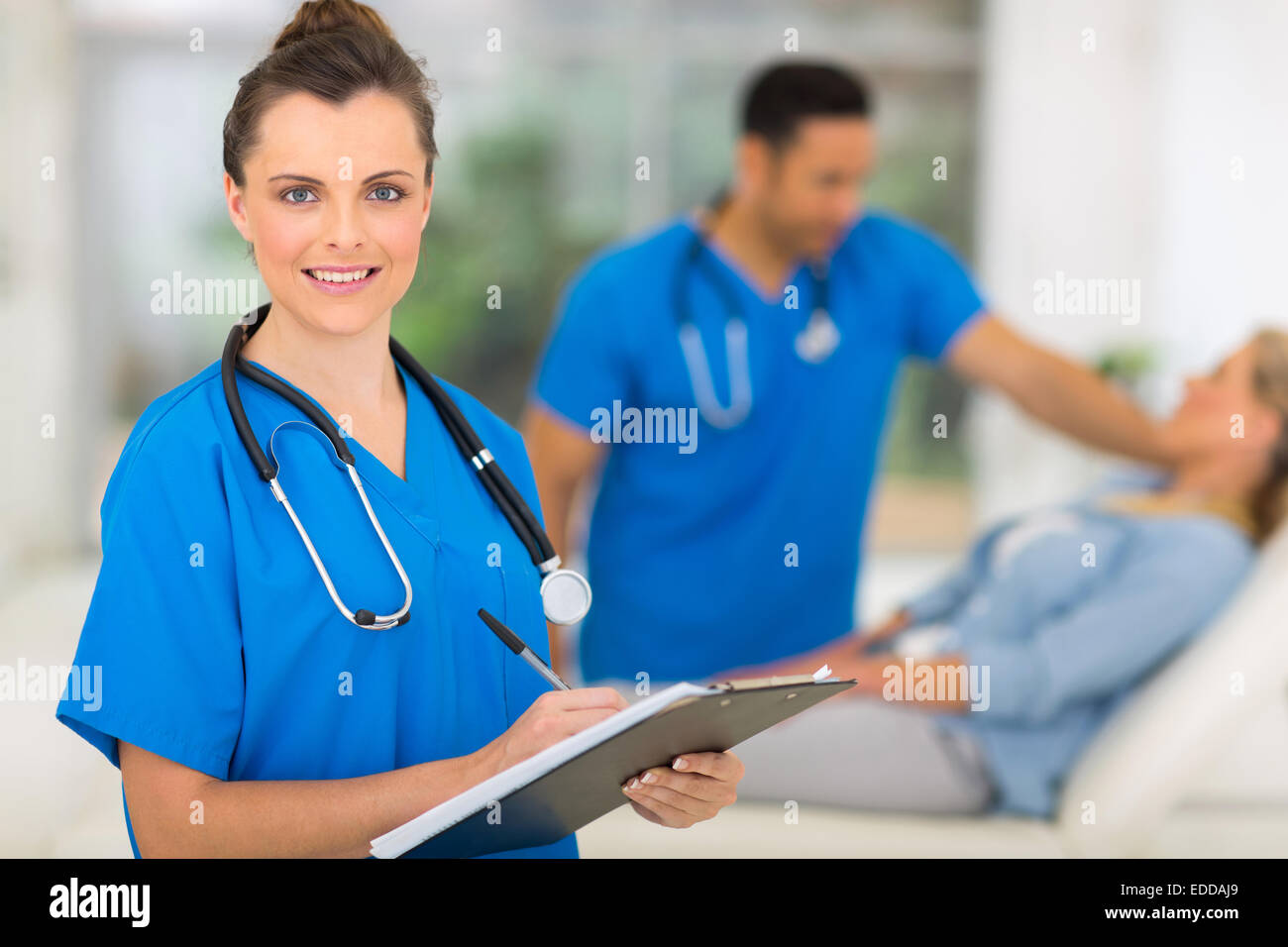 portrait of gorgeous nurse holding clipboard - Stock Image