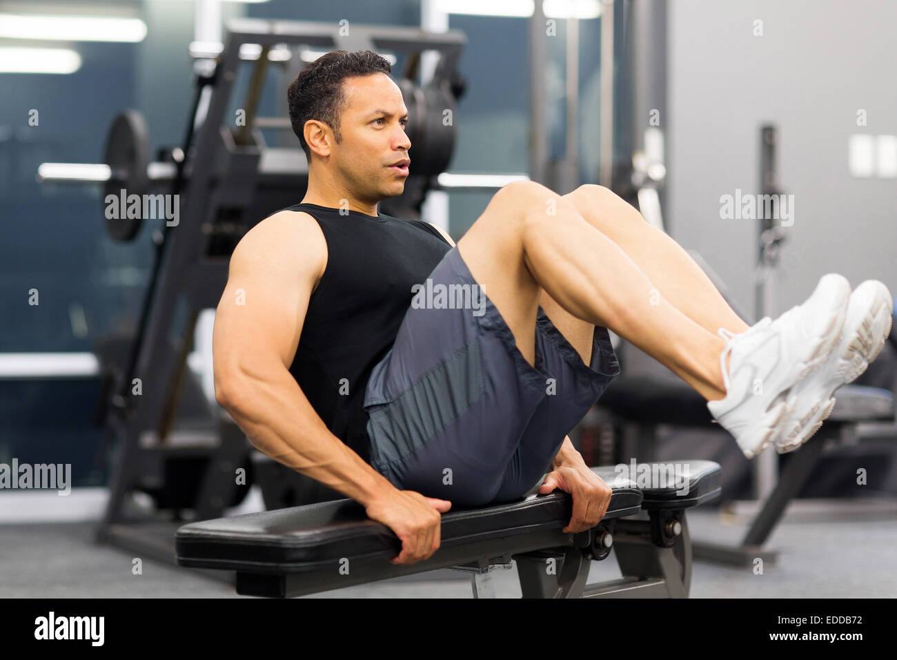 muscular man working out in gym - Stock Image