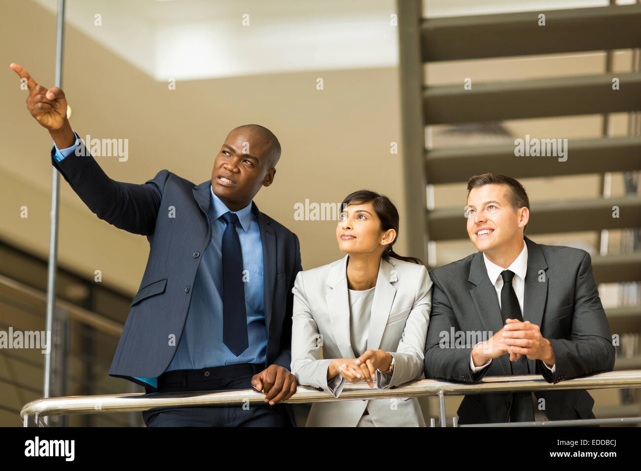 successful business group discussing work in modern office - Stock Image