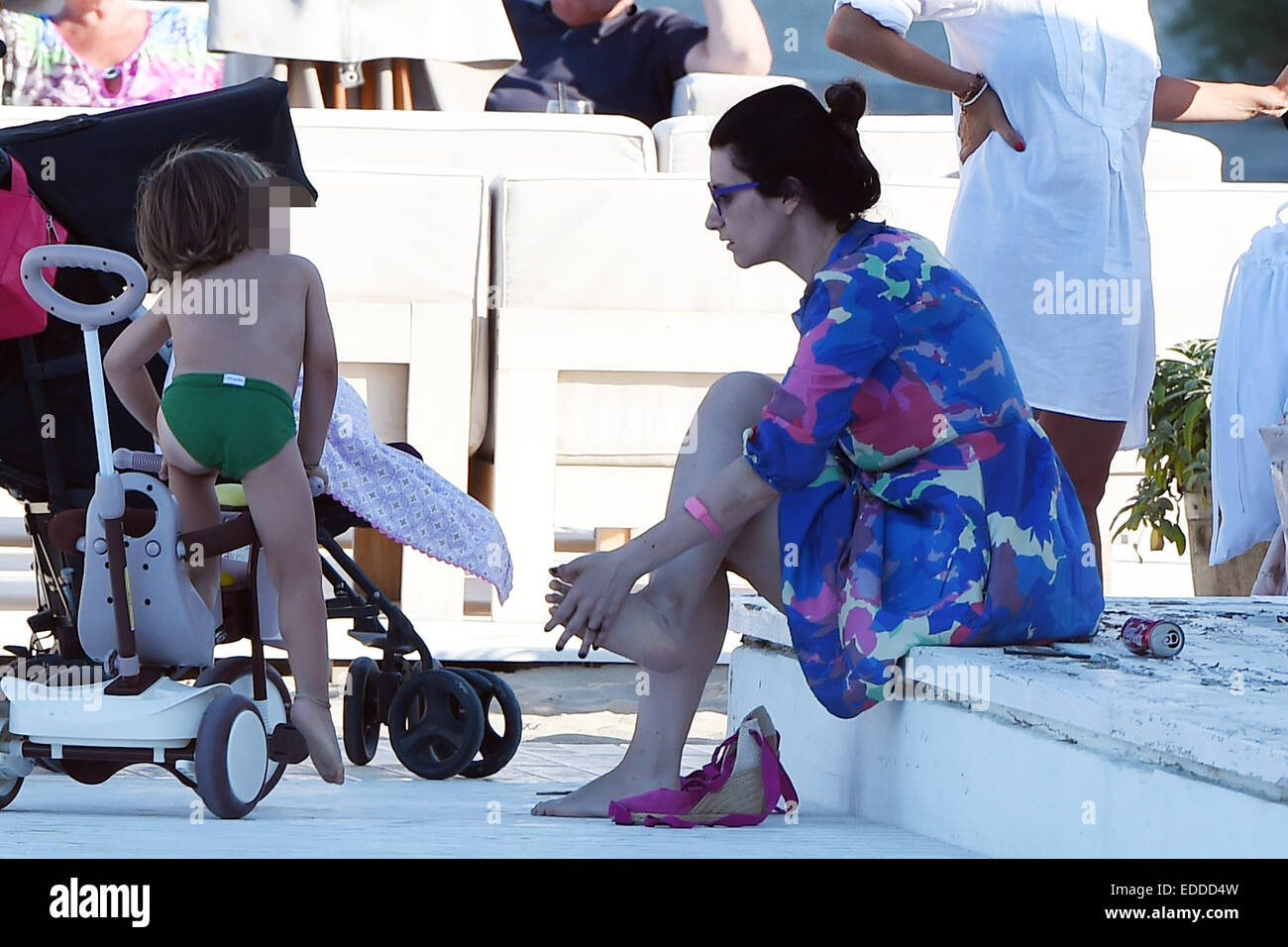 Italian pop singer and record producer Laura Pausini enjoys a day on the beach with her daughter Paola and family Stock Photo
