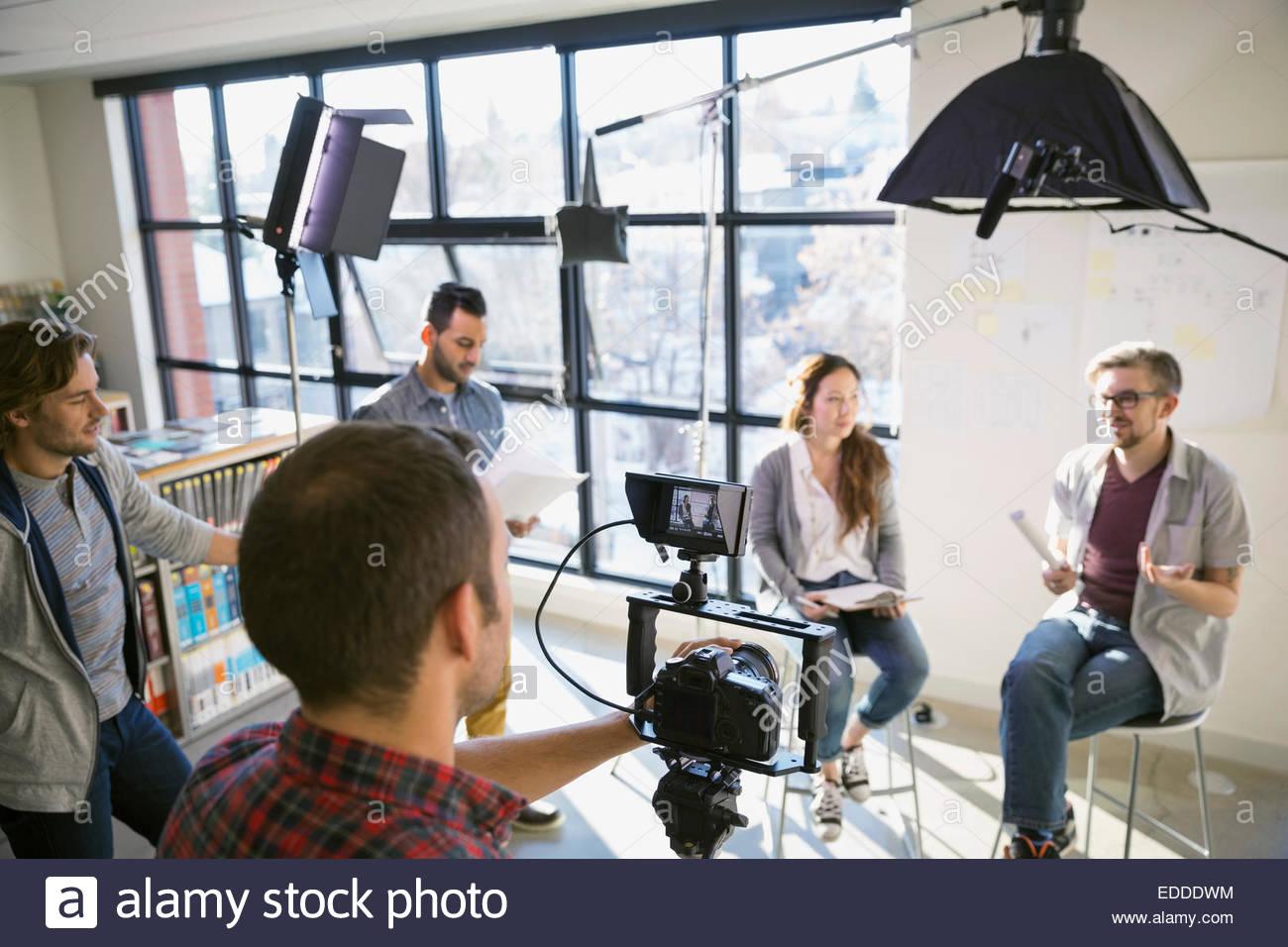 Business people shooting video tutorial - Stock Image