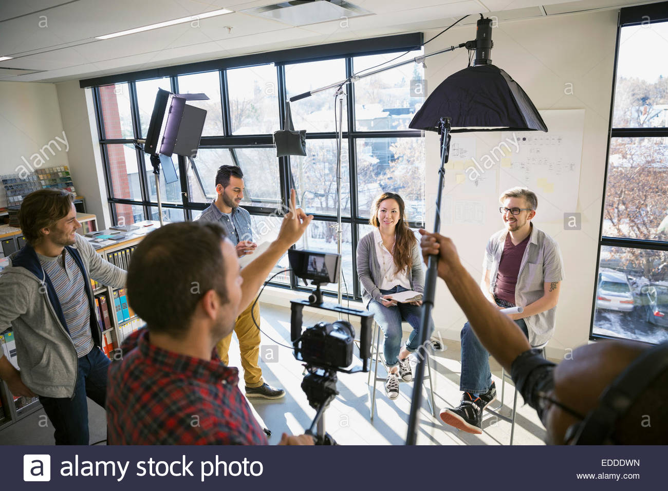 Business people shooting video tutorial - Stock Image