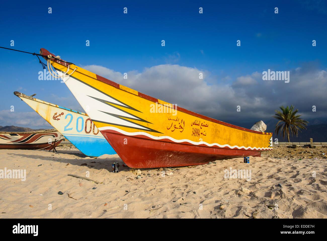Colourful fishing boats on the beach, Hadibu, island of Socotra, Yemen - Stock Image