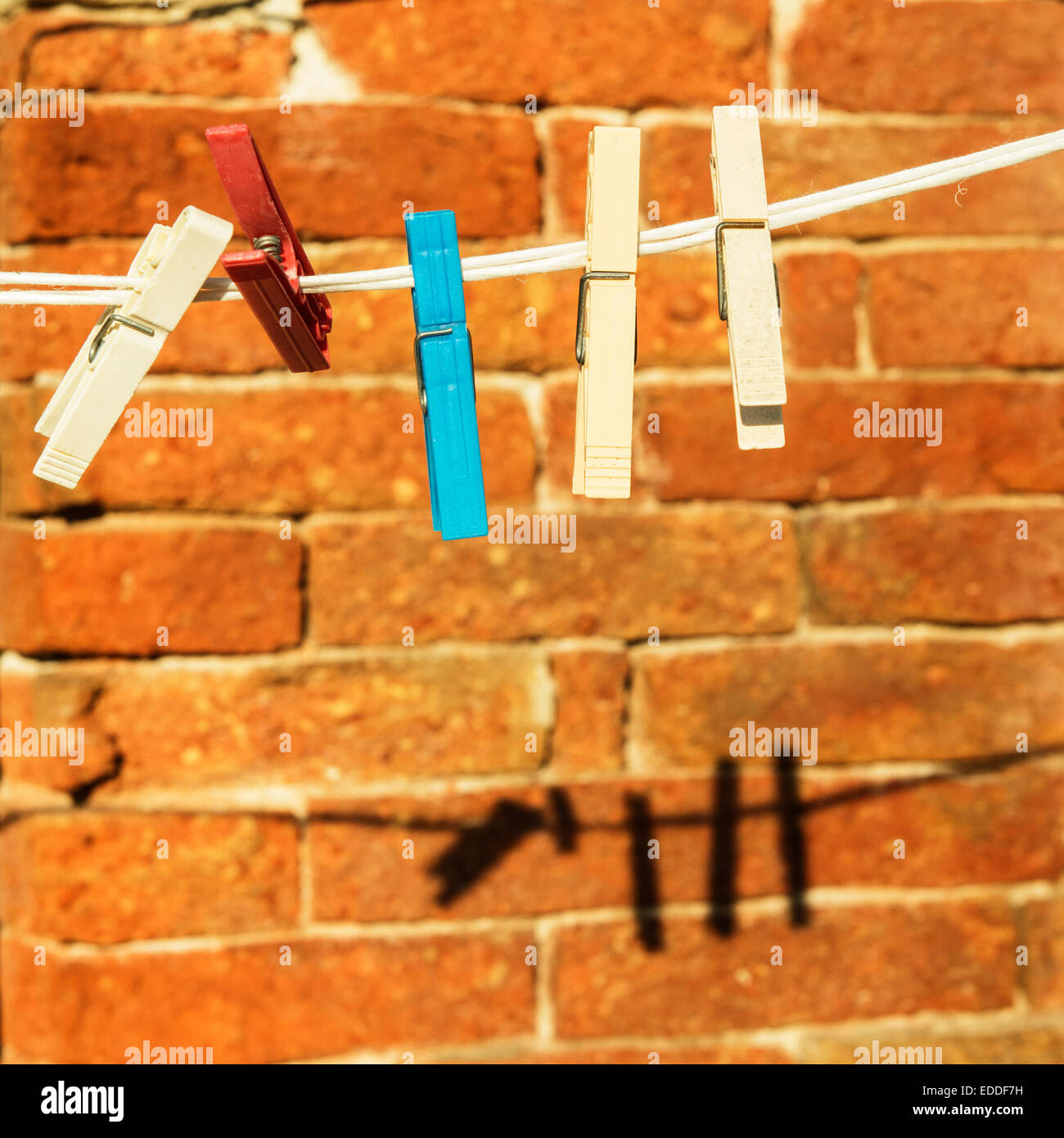 pegs and the shadows on the wall - Stock Image