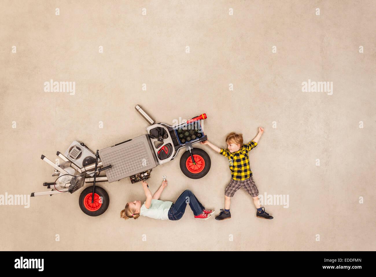 Kids assembling motor vehicle - Stock Image