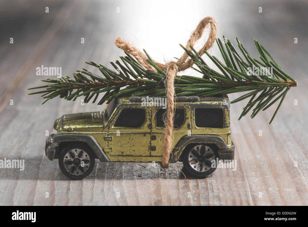 SUV car toy with Christmas tree on roof - Stock Image