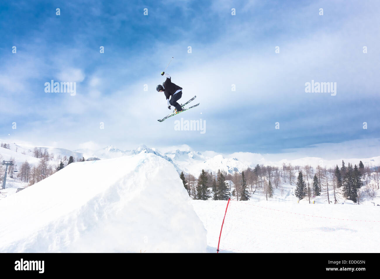 Free style skier performing a high jump - Stock Image